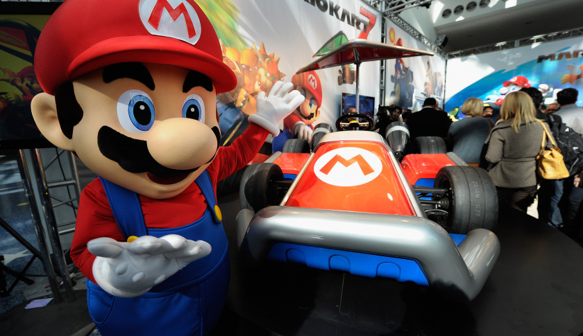 LOS ANGELES, CA - NOVEMBER 17: Nintendo game character Mario stands next to the new gamer-themed car built by West Coast Customs on November 17, 2011 in Los Angeles, California. The car show opens to the public tomorrow and runs through November 27. (Photo by Kevork Djansezian/Getty Images)